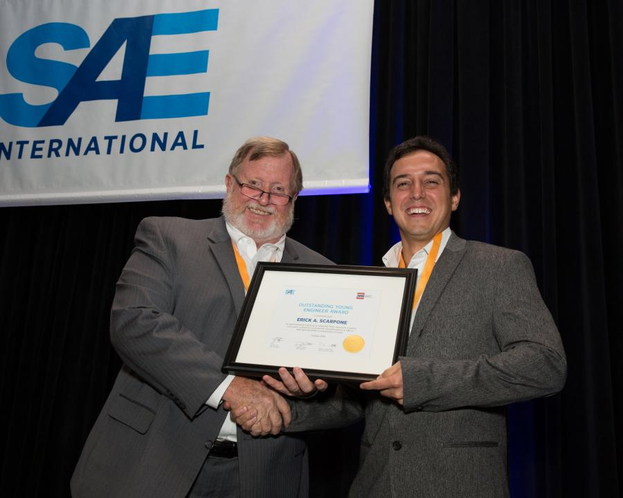 Award winner Erick Scarpone (R) and Thomas Stover, SAE Commercial Vehicle Sector Vice President (L)