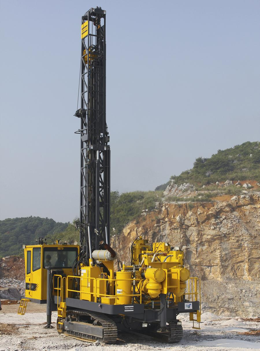 The DM30 II is ideal for the large quarry market, filling the gap between some larger and smaller drill rigs in the Atlas Copco range. The Atlas Copco DM30 II features a 30-ft. (9 m) drill pipe changer and a standard 4-rod carousel. With a starter rod under the rotary head, the DM30 II has a total depth capacity of 145 ft. (44 m).