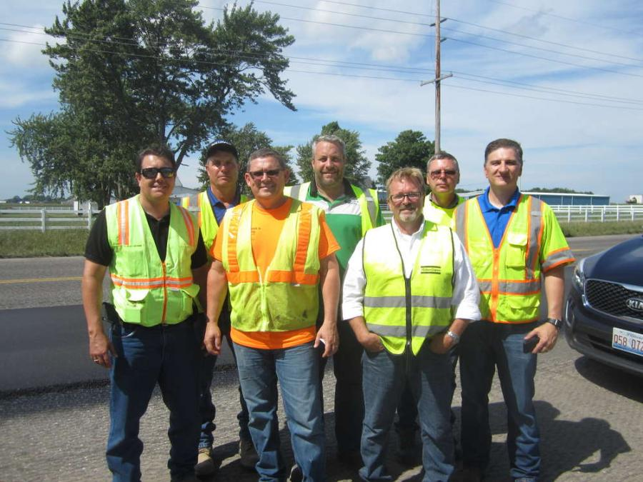 (L-R, Front) are Rich Forrest, Atlas Copco/Dynapac; Jim Padgett, Walsh & Kelly Inc.; Peter Fredrickson, Atlas Copco/Dynapac; and Tim Hoffman, Atlas Copco/Dynapac.  (L-R,?Back) are Jerry Bickner, Topcon Solutions; Nick Relias, Walsh & Kelly Inc.; and Russ Ciesiolka, Topcon Solutions.