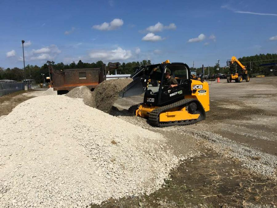 The operator of the JCB 260T compact track loader tests its capability.