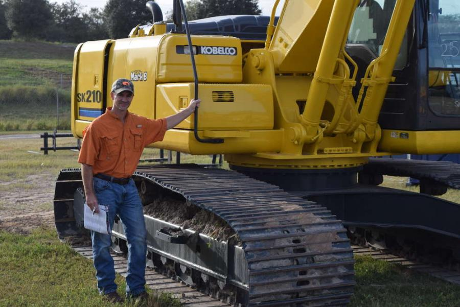 Mark Yarbrough, Intrac Corporation, Plant City, Fla., tests this Kobelco excavator SK210.