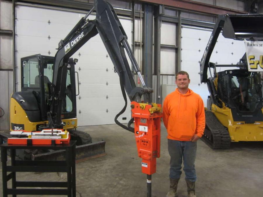 Daniel Murphy of Murphy Logging inspects this John Deere 35G mini-excavator equipped with a NPK PH-2 hydraulic hammer.