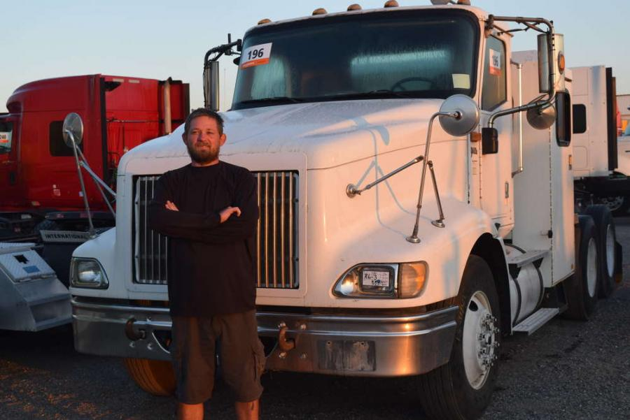 Jake Cook, C&K Timber, Deland, Fla., considers bidding on this International  9400i  semi truck.