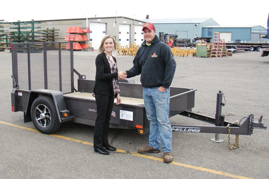 Brenda Jennissen (L), Felling Trailers' president/CEO, and Patrick Stepan of Sauk Center, Minn.