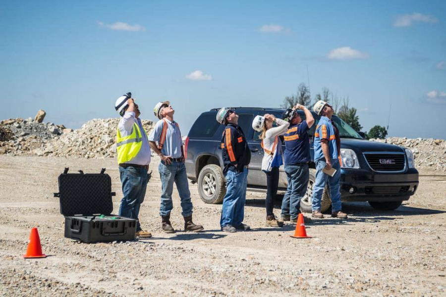 Construction managers watch as an Identified Technologies Corporation drone flies over a project, taking pictures that will be used to create a map of the site. (Identified Technologies photo)