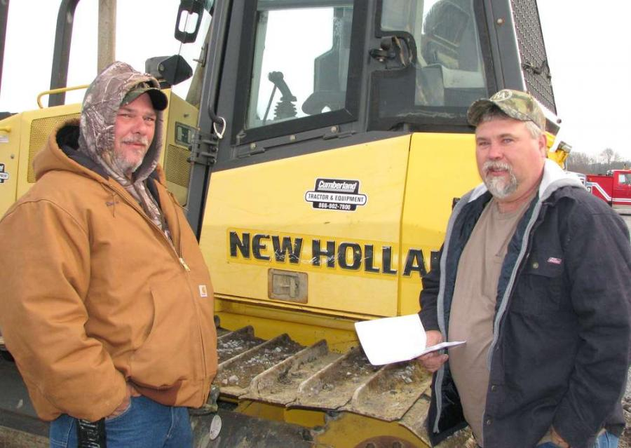 Randy McReynolds (L) and Kevin Butcher, both of Butcher Farms, McMinnville, Tenn., look for bargains at the auction.