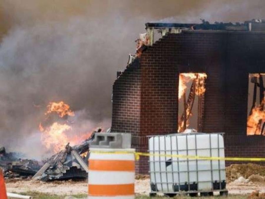 Knoxville Fire Department spokesperson D.J. Corcoran said the Southeast Bank building under construction at Kingston Pike near Homberg Drive caught fire on Thursday. (Photo: Michael Crowe, WBIR)