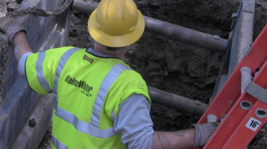 Maine Water employees at work replacing aging water infrastructure.