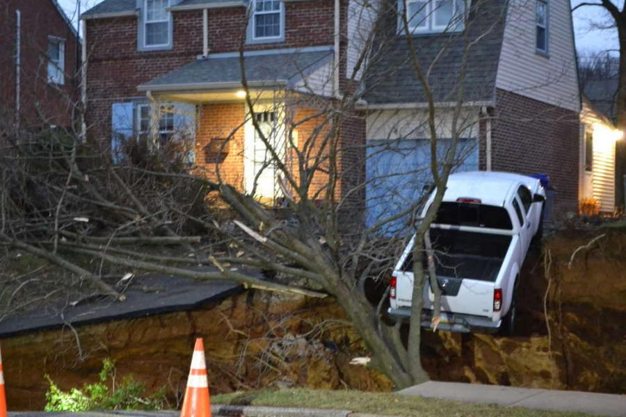 A massive sinkhole opened up on Brooke Road in Glenside on Wednesday. EMILY CASHER LOOMIS
