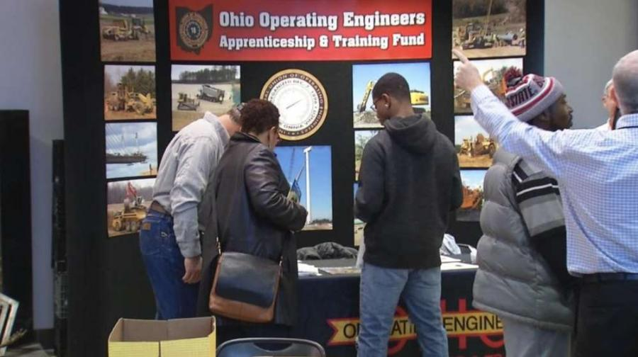 Attendants discuss the possibilities and potential for work with heavy equipment. (WSYX/WTTE)