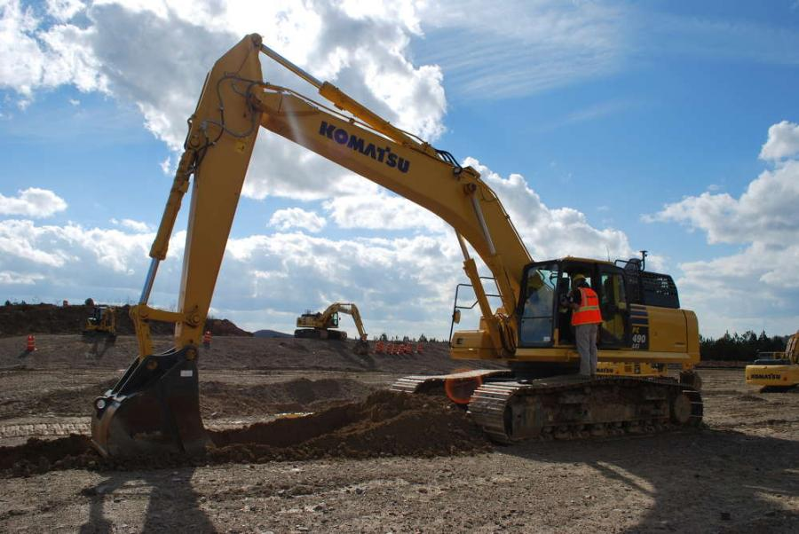 Student learning how to operate a Komatsu PC490LCi-11.