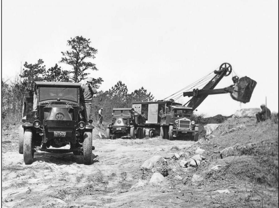 National Archive photo - Arute Bros. Inc. of Bridgewater, Mass., held the contract for the relocation of the highway on the south side of canal made necessary by the canal widening project. Arute is using a Bucyrus- Erie 43-B shovel with a 1-3?4 cu. yd. (1.34 cu m) dipper to load heavy duty Mack AC and Sterling chain drive dump trucks. The photo was taken on May 1, 1935.