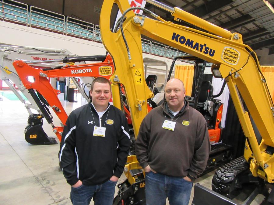 Cory VanHouten (L) and Jeff Richards, Columbus Equipment Company, answer questions about the Takeuchi, Kubota and Komatsu machines on display.