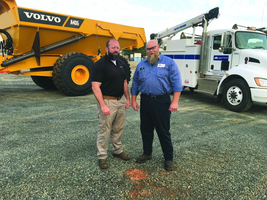 Patrick Overstreet (L), director of product support and Al Shank, service technician, stand in front of one of the company's new Kenworth T270 field service trucks