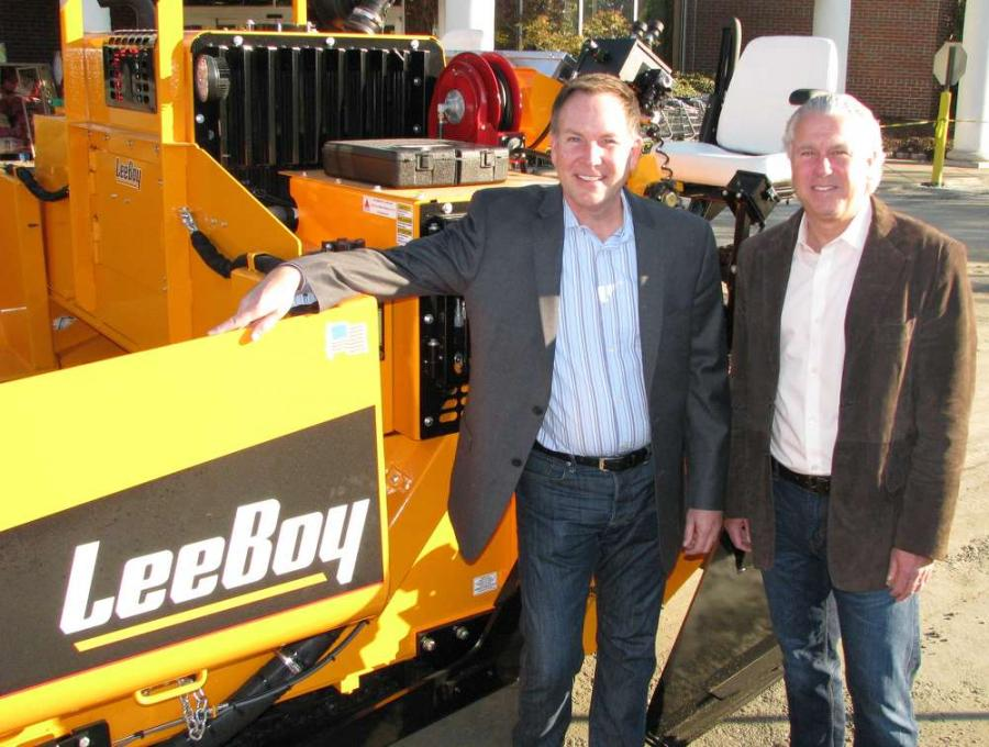 Brad Kaufman (L), co-owner and president of Blackjack Paving, and Jay Herzog, co-owner of Blackjack Paving, take delivery of brand-new LeeBoy 8515 D asphalt paver at the job site just off Cascade Road in southwest Atlanta.