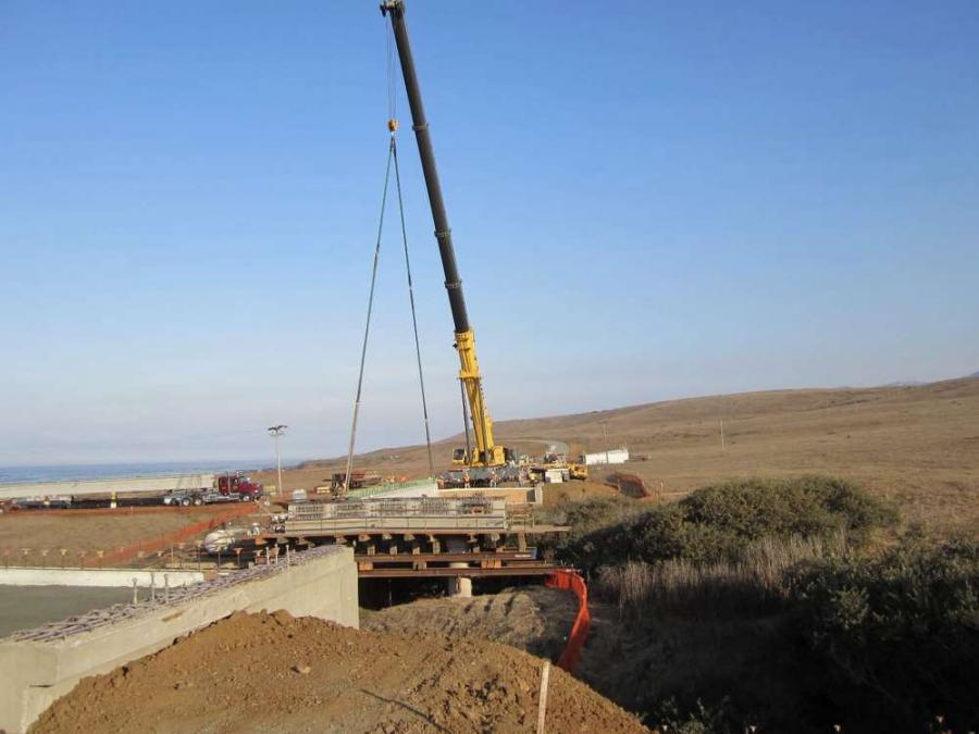 Crews place precast girder at Arroyo Del Oso.