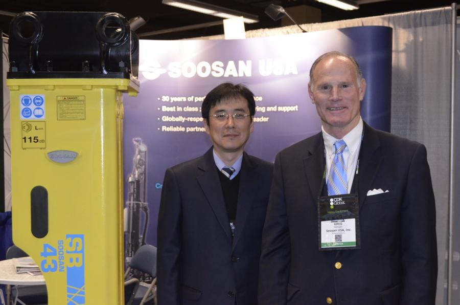 Sung Jong Kee (L), director, and Greg Henry, sales manager, were on hand at AED to help introduce dealers to the Soosan hydraulic hammer line.