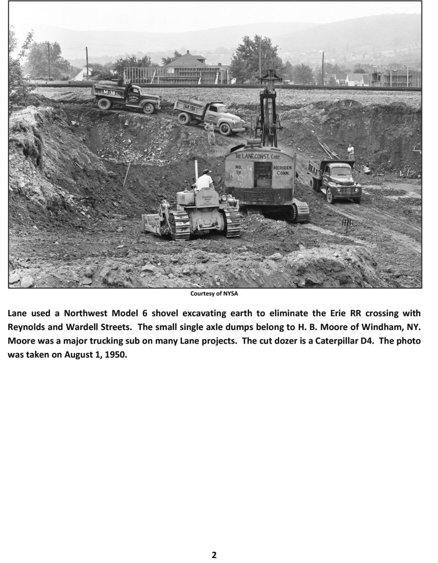 NYSA photo Lane used a Northwest Model 6 shovel excavating earth to eliminate the Erie RR crossing with Reynolds and Wardell Streets. The small single axle dumps belong to H. B. Moore of Windham, N.Y. Moore was a major trucking sub on many Lane projects. The cut dozer is a Caterpillar D4. The photo was taken on Aug. 1, 1950