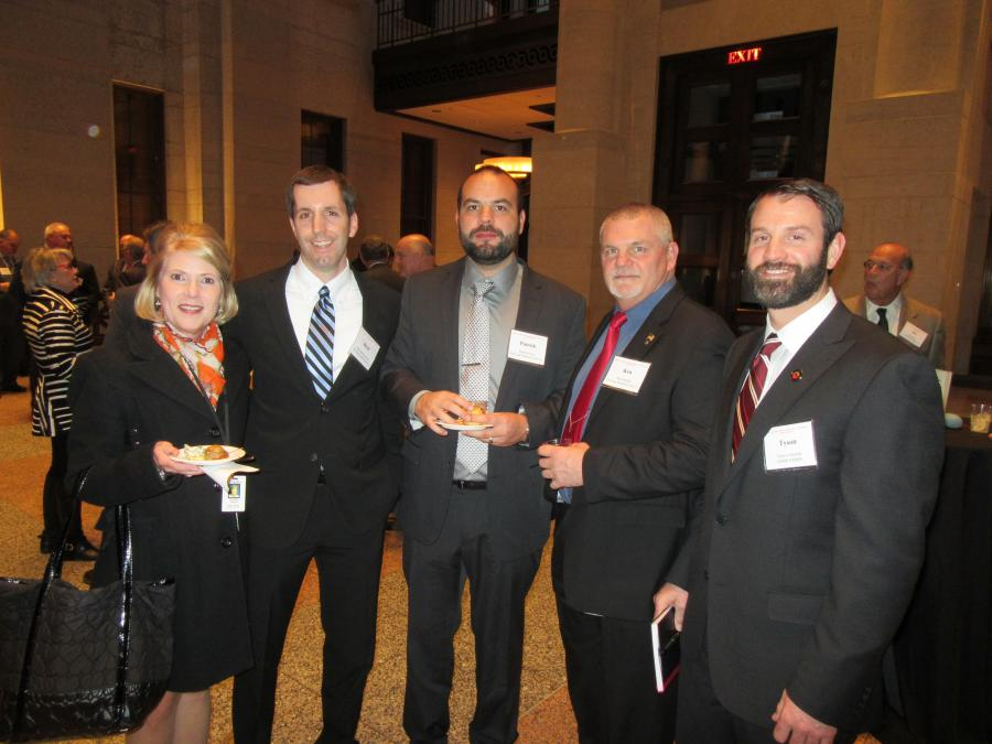 Dorothy Pelanda (L), majority house leader, House District 86, spoke with (L-R) Brett Bartholomew, Patrick Gray and Ken Rambo of East Fairfield Coal Company; and Tyson Lamielle of ODNR DMRM at the reception.