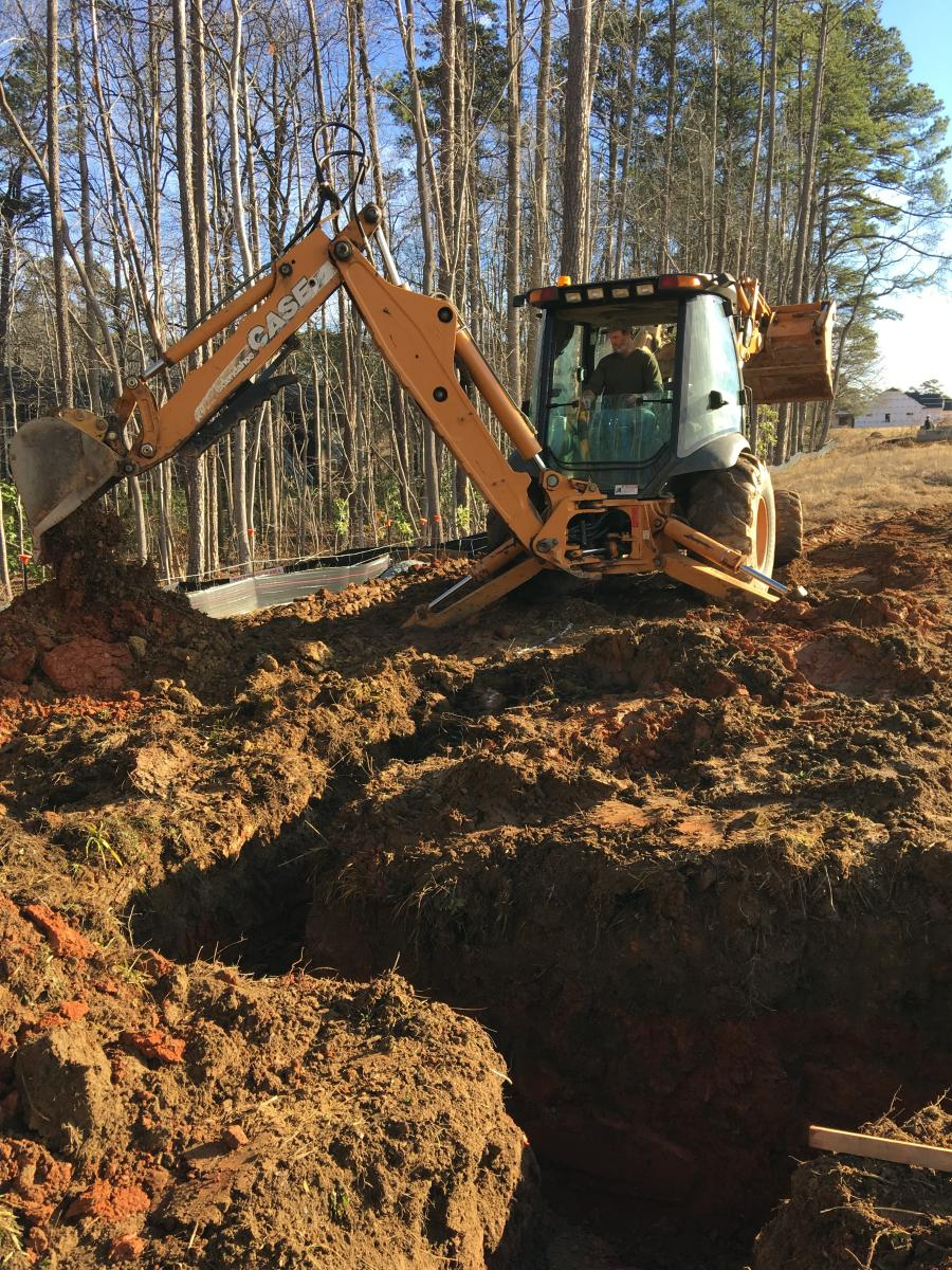 """The Case 590 backhoe also has a wide stance, which gives it stability. I'm often on hills and inclines, so when I have wider tires, I feel a bit safer,"" said Shannon Hawkins, Hawkins Backhoe & Septic, Whitsett, N.C"