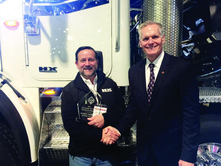 Robert Feldman (L) of Mid-Atlantic Truck Centre and Bill Kozek, president, trucks and parts, Navistar, celebrate Feldman being named grand champion of the 2017 HX Series Walk-Around Competition.