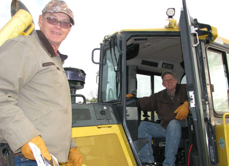 Jimmy (L) and his brother, Ellis Cofield, independent contractors based in Eastman, Ga., check out a Komatsu D65WX dozer