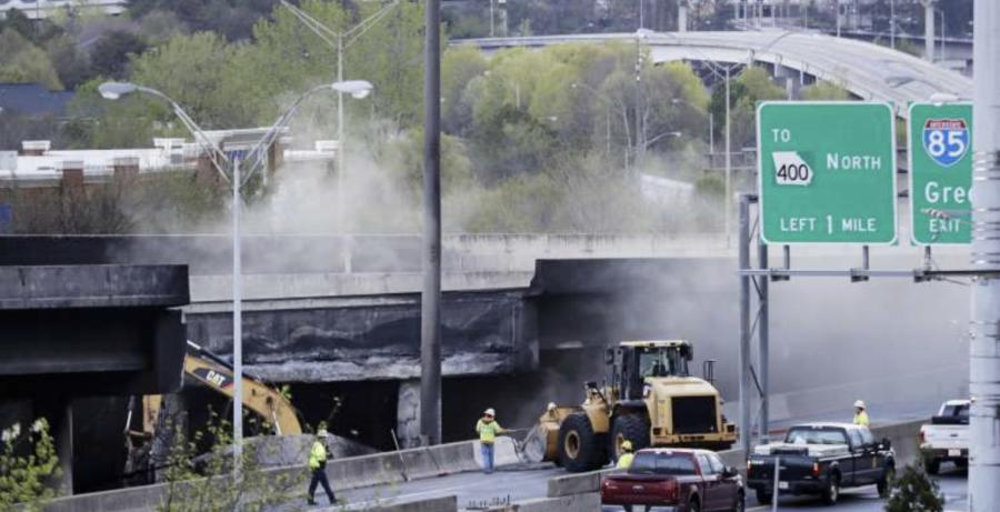 Crews worked to clean up the remaining rubble and debris leftover from a massive fire destroyed the bridge connecting commuters to the northern suburbs of Atlanta.