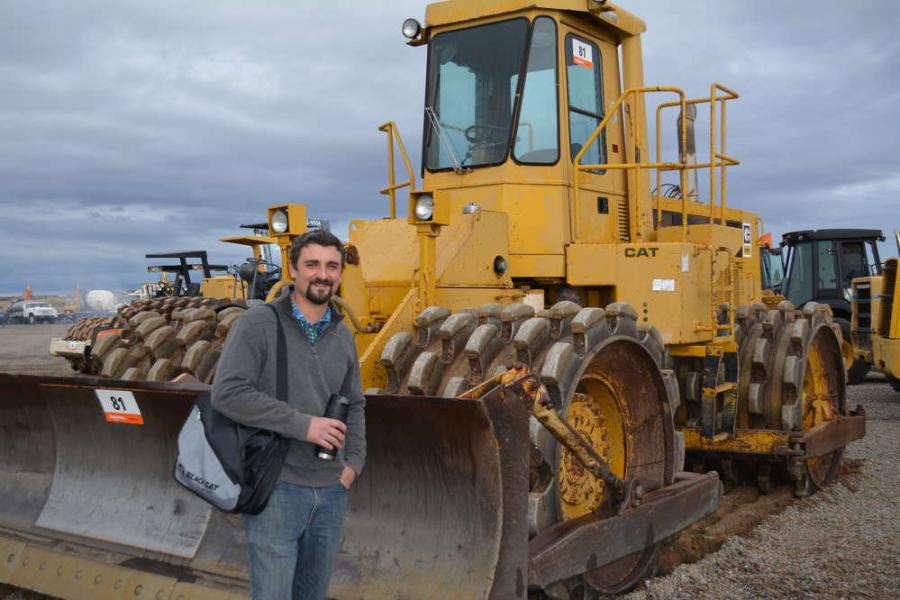 Jeremy Monjure of SW Construction Parts in Albuquerque, N.M., checks out the Cat 825C compactor, vintage late '80s.