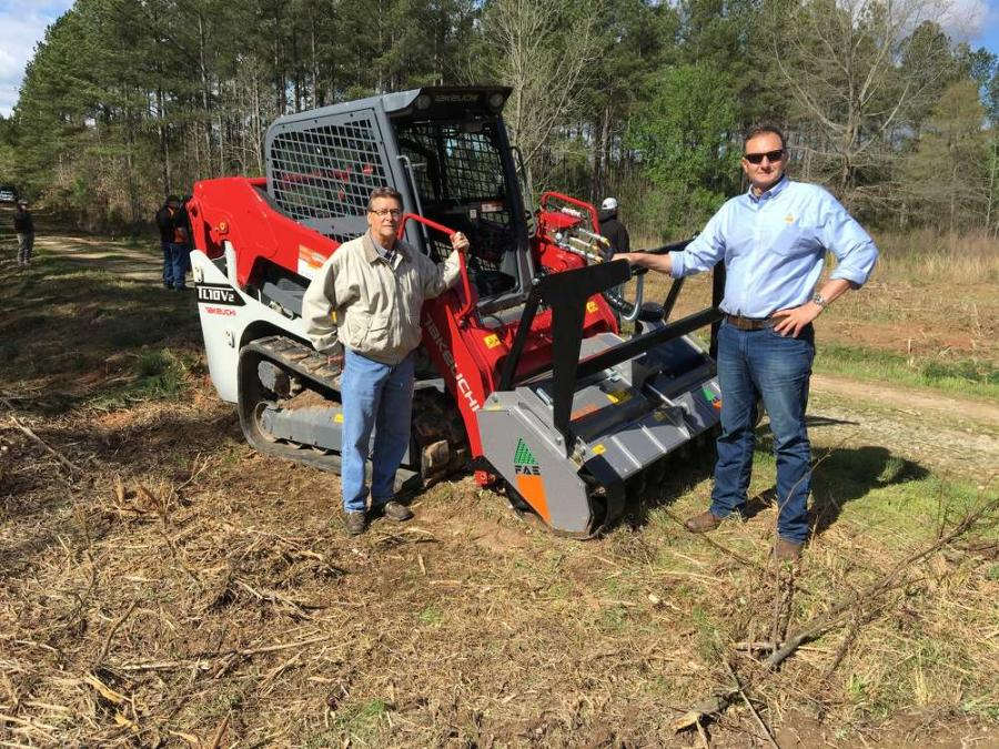 Dean Hoffman (L) of Takeuchi and Giorgio Carera, CEO of FAE USA Inc., showcase the FAE DML-SSC 150 mounted on this Takeuchi TL10V2.