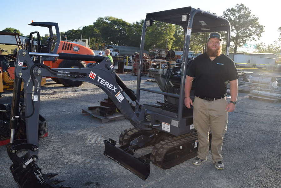 Brian Smith of NextLot Auction makes sure this Terex mini-excavator was ready to go.