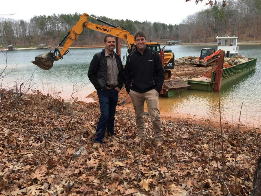 Robbie Lee (L), owner of Lee's Ground Covers Plus, and Crayton Wilson, May Heavy Equipment.