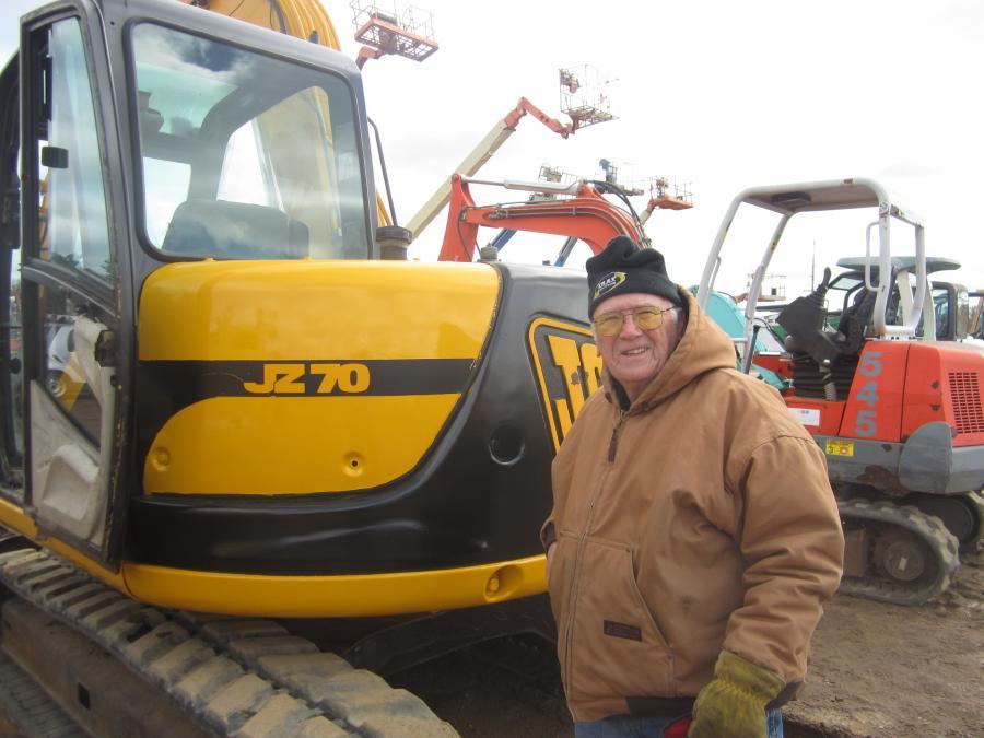 Wayne Rambo of Rambo Salvage Yard looks over this JCB JZ 70 excavator.