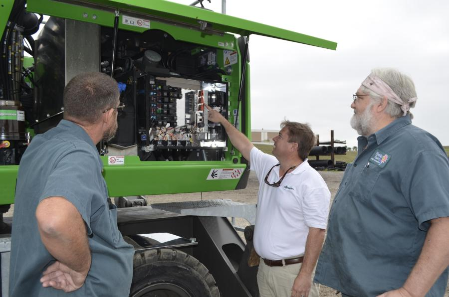 Ryan Zenor of Sennebogen shows the electric relay system featured on the Sennebogen 818 E to Pinellas County employees