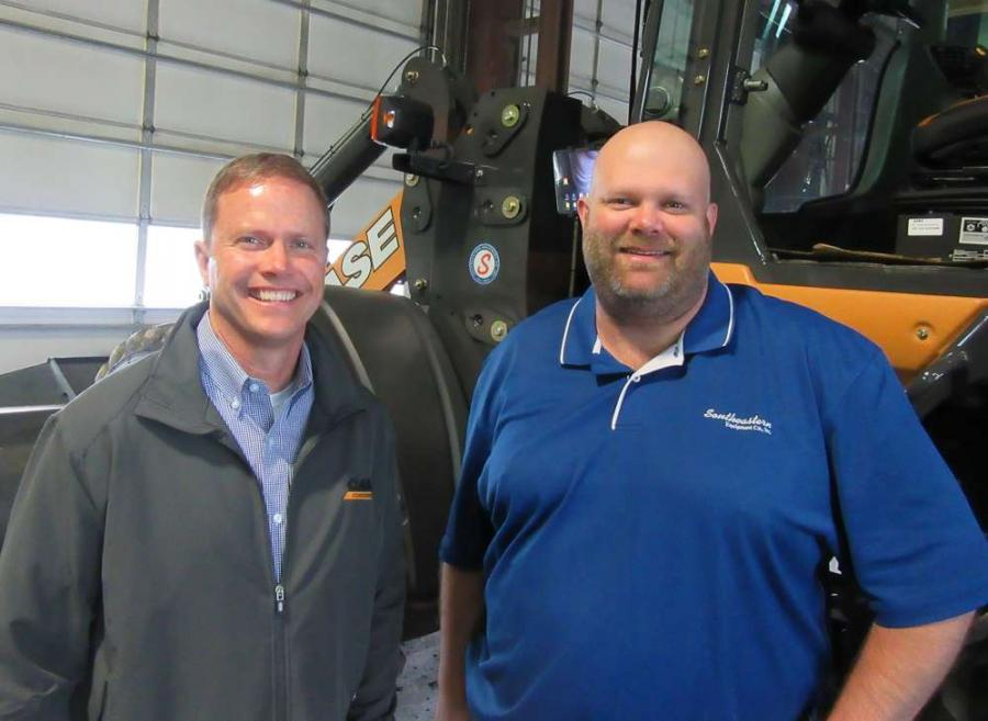Adam Doll (L), Case territory manager, teams up with Southeastern Equipment Company's Jon Wickline to welcome attendees at the dealership's Dublin open house event.