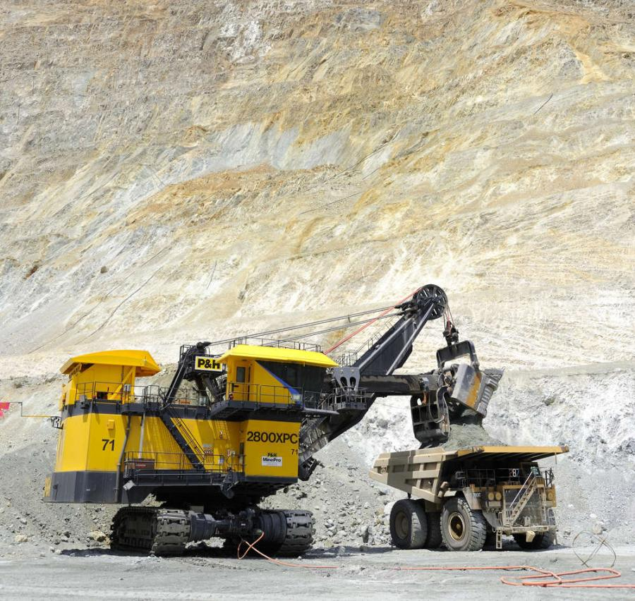 The shovel's dipper or bucket holds more than 100 tons (90.7 t) of material — three scoopfuls and a 320-ton haul truck is ready to roll.