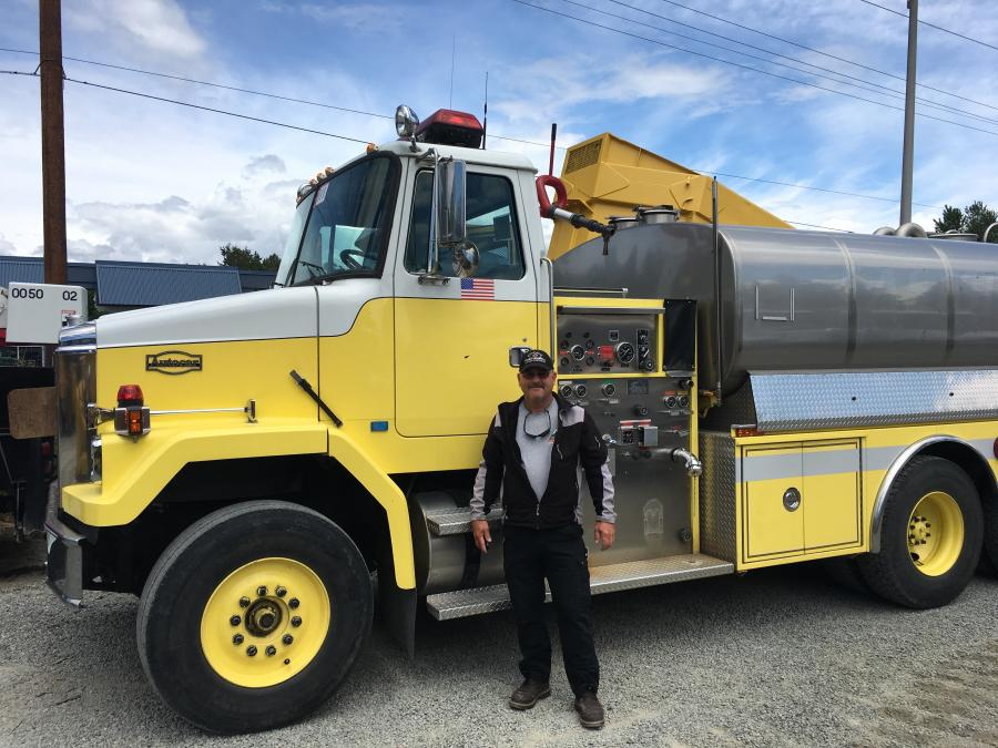Jeff Storey stands proudly after winning the bid on this 3,000 gal. watertruck/fire tender.