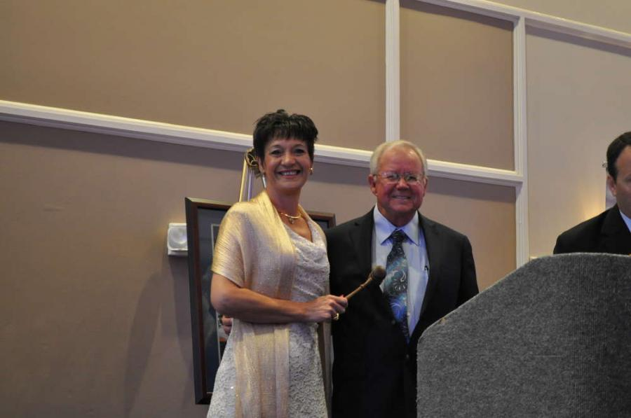 2016 to 2017 GUCA President Charlotte Garrett, Rockdale Pipeline Inc., passes the gavel to newly elected 2017 to 2018 GUCA President Billy Crump, LaKay Enterprises Inc.