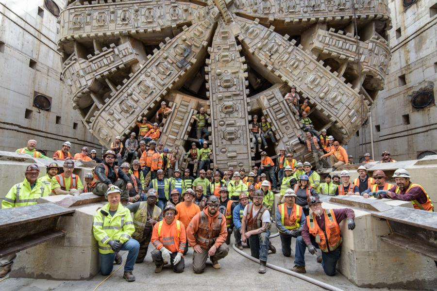 In this April 2017 photo, tunnel workers pose with the SR 99 tunneling machine after Bertha moved into the disassembly pit near Seattle Center.