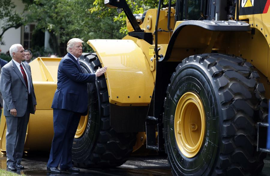 President Trump and Vice President Pence examine Caterpillar's 966M wheel loader at the White House July 17. (Photo Credit: Alex Brandon/Associated Press)