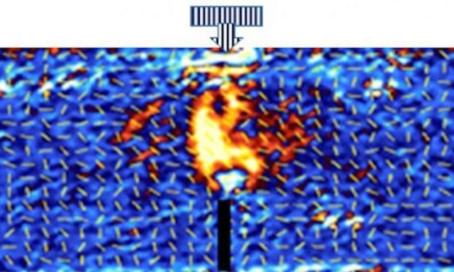 This picture from a photonic camera shows how using the coating can create a candle-like 'flame' that highlights shear stress distribution in a sample concrete beam. (Photo Credit: University of Leeds)