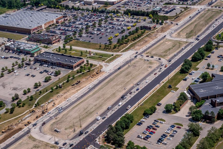 The 90,000 cars and trucks that daily travel along a 3.7-mi. stretch of M-59/Hall Road between M-53 and Romeo Plank are the biggest challenge for the crews of Angelo Iafrate Construction as they work to complete the $60 million rebuilding of the highway.