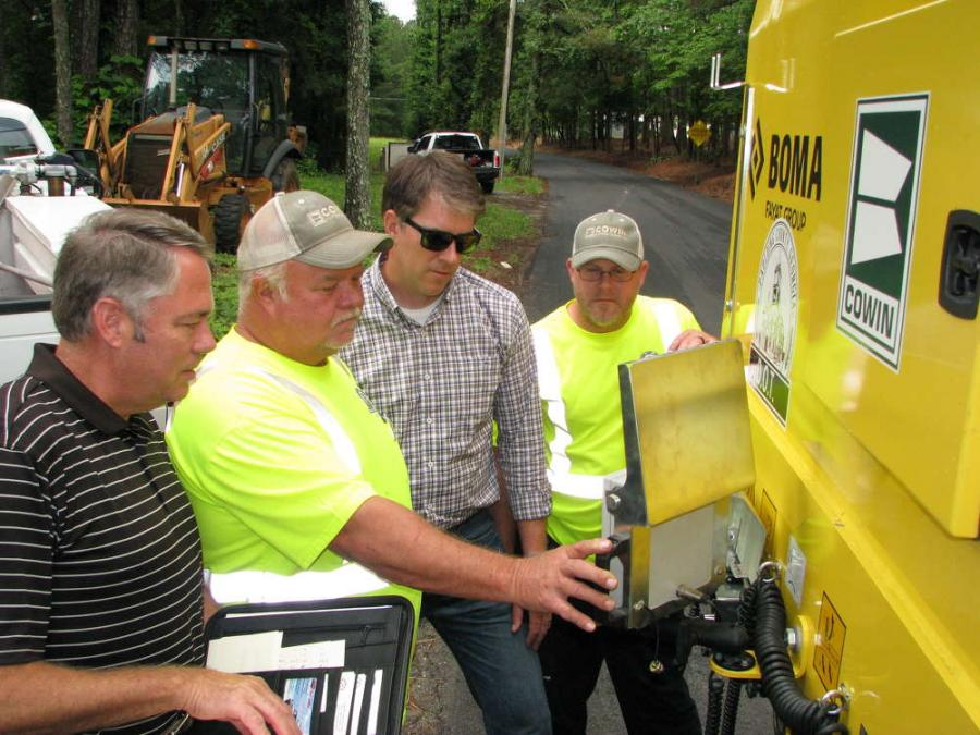 (L-R): John Edwards, Cowin Equipment Company; Jimmy Cole, Paulding County DOT; Andrew Bell, Cowin Equipment Company; and Michael Steele, Paulding County DOT, recalibrate the machine for a 1.5-in. cut.