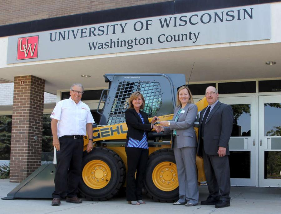 (L-R): Kelly Moore, product and training specialist, and Lori Heidecker, marketing director, both of Manitou Americas, present the keys of a new Gehl R190 skid loader to Courtney O'Connell and Jon Etta at UW- Washington County.