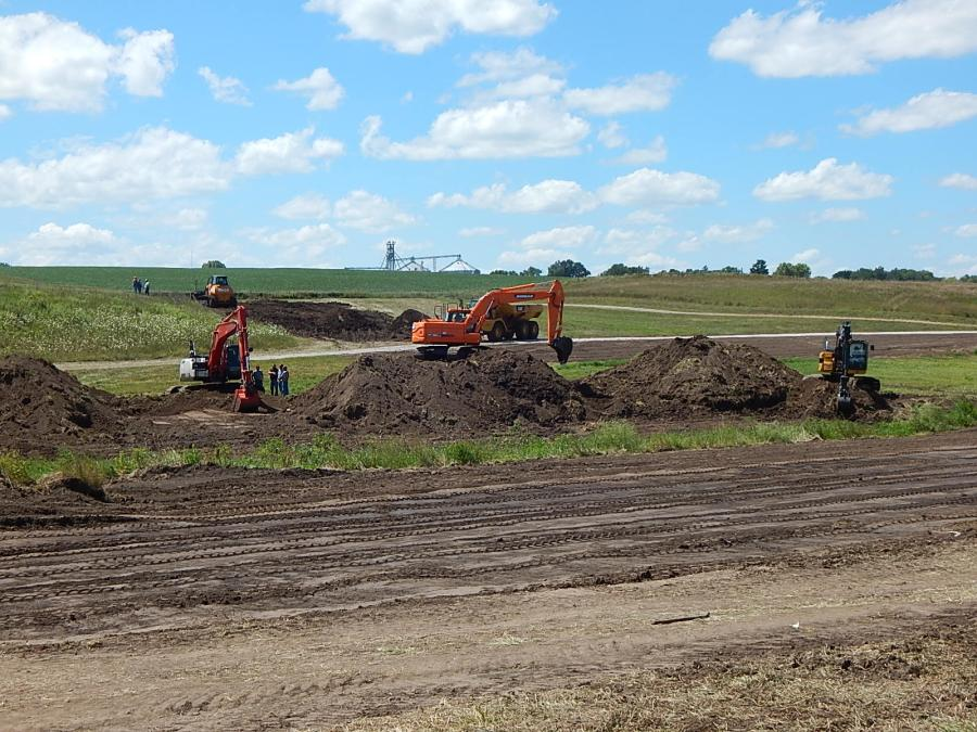 On the other side of the pond, haul trucks, bulldozers and excavators were working to complete the last of the conservation practices to be implemented on the farm.