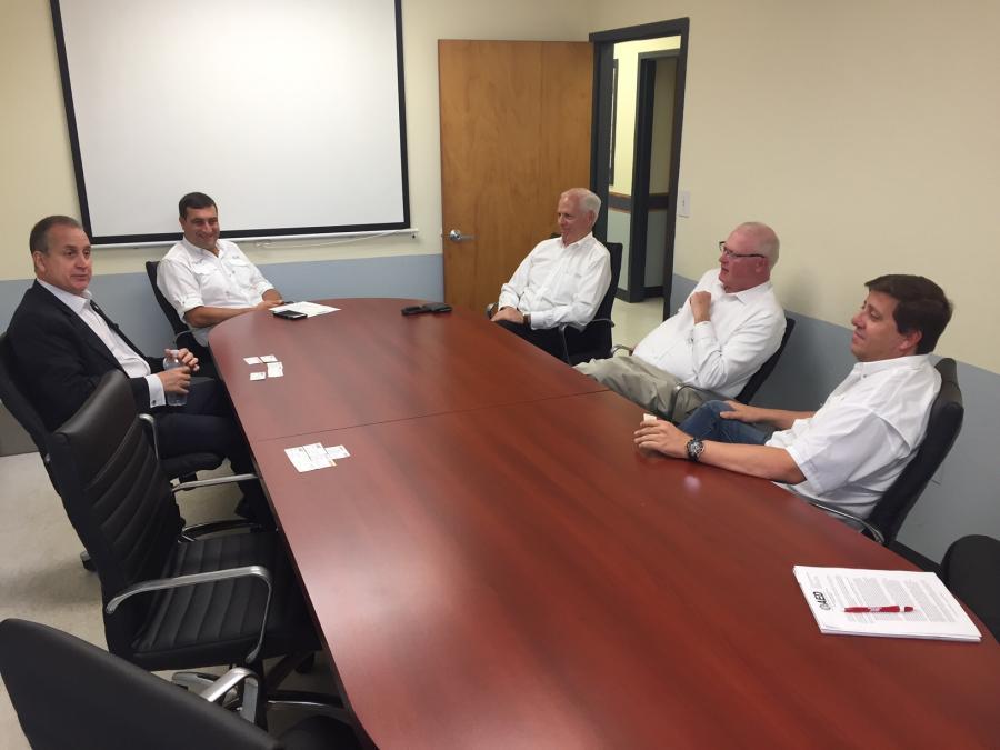 (L-R) are Congressman Mario Diaz-Balart; Ronald Miller, managing director, Trekker Group; Bob Henderson, executive vice president, AED; Brian McGuire, president and CEO, AED; José Cestero, president and CEO, Trekker Group.
