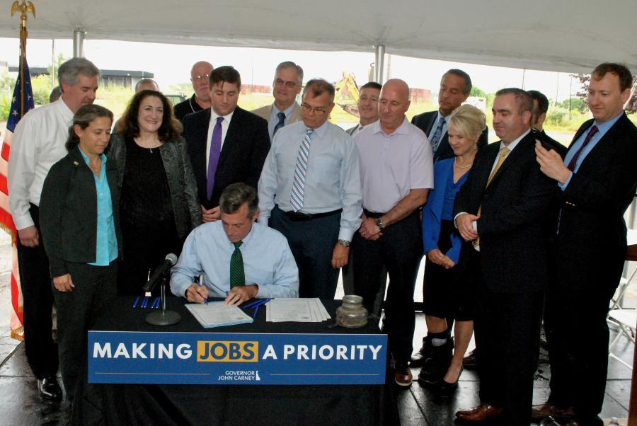 Gov. Carney signs House Bill 190 to modernize the Coastal Zone Act.