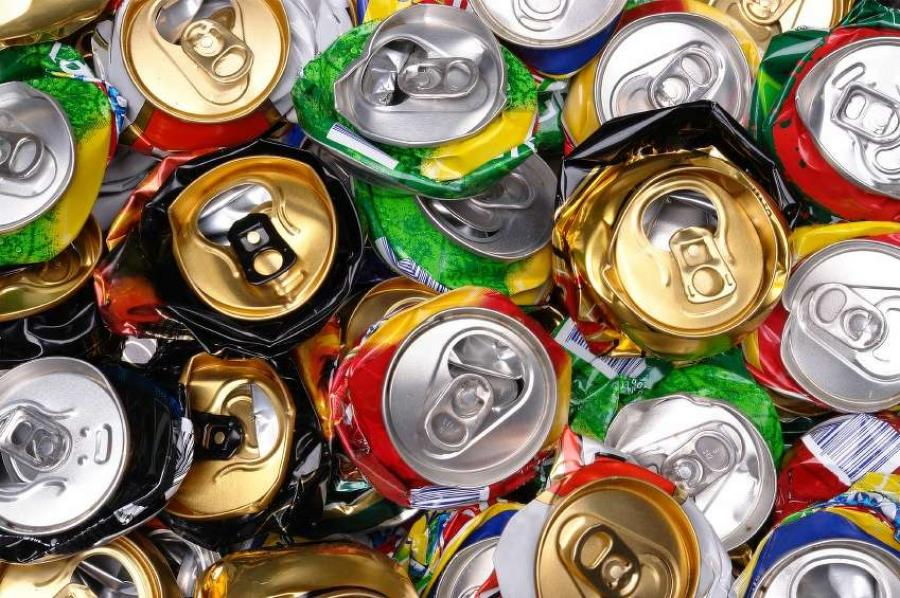 Eli Harting collects and crushes cans for recycling to save up for college. (greenerpackage.com photo)