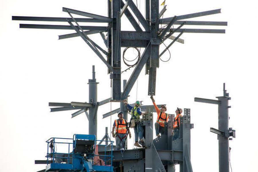 Crews erected a 130-ft. star-shaped steel spire with a crane