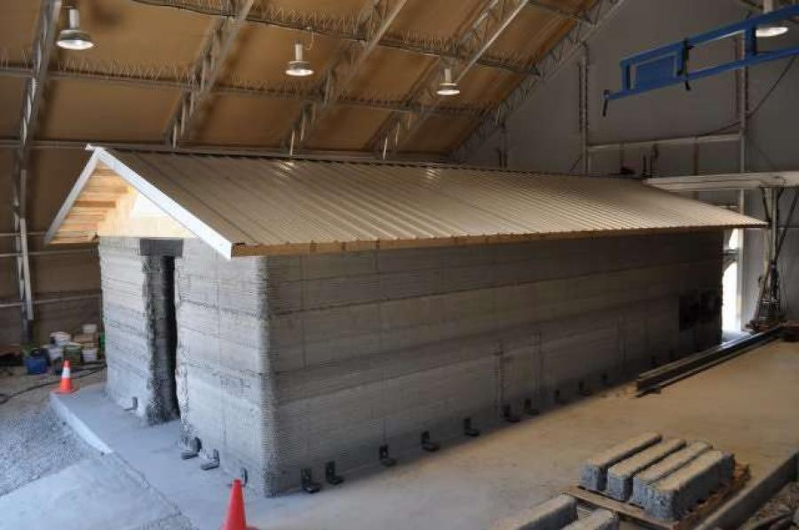 The barracks hut, or B-Hut was created via an additive manufacturing process, which allows semi-permanent buildings to be printed using concrete made from available materials. (Photo Credit: Michael Jazdyk)