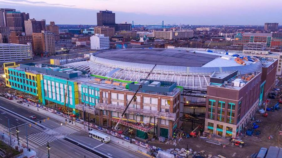 Construction workers have been working nights and weekends on the $863 million arena, finishing up last-minute projects, including laying pavement outside the southeast entrance, the Detroit Free Press reported.